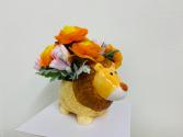 Silk Arrangement in a ceramic lion Silk Arrangement