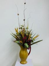 Silk arrangement in ceramic pitcher  Silk Arrangement