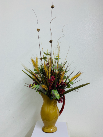 Silk arrangement in glass pitcher  Silk Arrangement
