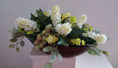 Silk flowers in wooden container Silk Arrangement
