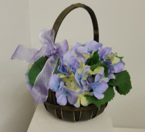 Silk lavender hydrangea in green basket Silk flower arrangement
