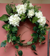 Silk, outdoor or indoor wreath  White hydrangea and garden foliage.