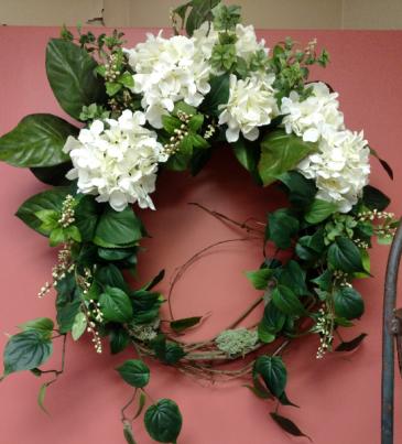 Silk, outdoor or indoor wreath  White hydrangea and garden foliage.