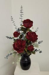 Silk red roses in black vase Silk flower arrangement