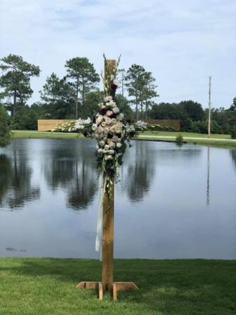 Cross ceremony florals