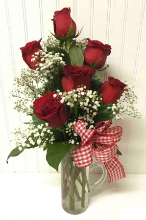 Six Red Roses in a Glass Pitcher