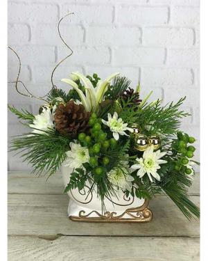 Sleigh Ride white sleigh, white flowers, greens,cones in Lebanon, NH | LEBANON GARDEN OF EDEN FLORAL SHOP