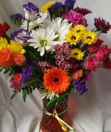 Smiles and Sunshine Bouquet...Bright assorted Flowers in a colored vase!