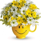 SMILEY FACE MUG WITH DAISIES ARRANGEMENT