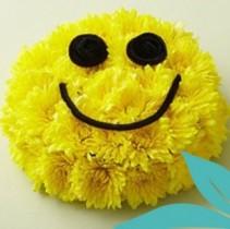 Smiling Emoji Floral Cake