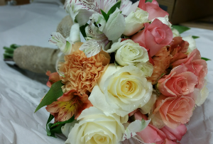 Soft Corals & Creamy Whites Hantied Burlap Bouquet in Plum, PA | FOREVER GREENE FLOWERS INC.