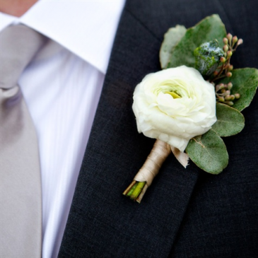 Soft White Ranunculus Boutonniere