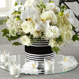 Solemnity In white  Wedding Centerpieces  in Oakville, ON | ANN'S FLOWER BOUTIQUE-Wedding & Event Florist