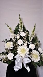 Snow white funeral arrangement