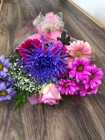 Sparkling pink and purple Wrapped bouquet