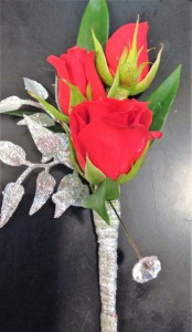 Sparkling Red Bout Boutonniere