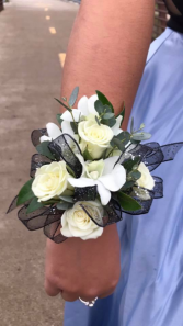 Spray rose and white dendrobium orchid wrist corsa Wrist corsage