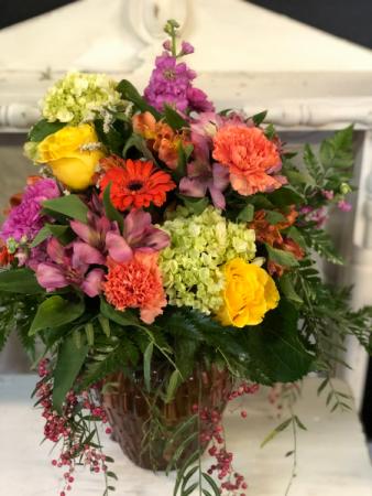 Spring in a vase mixed arrangement in colored vase