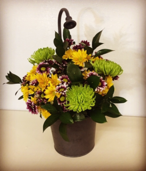 Spring Time Floral Designed in a Metal Water Spout Pot in Plainview, TX | Kan Del's Floral, Candles & Gifts