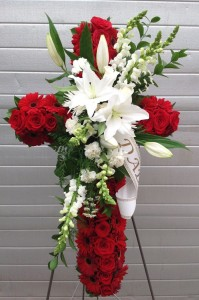 Standing Crosss Red roses and Gerber Daisies,With White Lilies