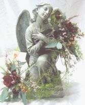 STATUE + FLOWERS We have a large selection of statuary for indoors and outdoors (in season). Allow us to decorate your choice with complimenting flowers and greens. Call for our current selection and pricing.