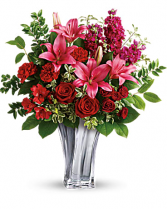 Sterling Love bouquet Sleek and chic, this sterling silver mirrored, blown glass vase adds a touch of modern luxury to this gorgeous bouquet of red roses and pink lilies.