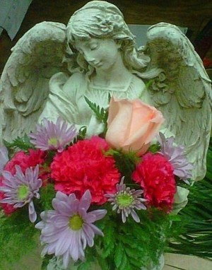 Stone Angel Arrangement  Sympathy in Elyria, OH | PUFFER'S FLORAL SHOPPE, INC.