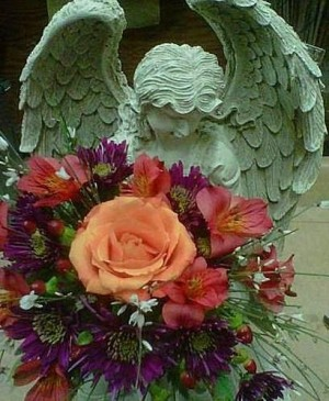Stone Angel Arrangement  Sympathy Funeral Arrangement in Elyria, OH | PUFFER'S FLORAL SHOPPE, INC.