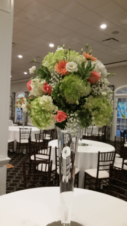 Stunning tall centerpieces Peach and greens
