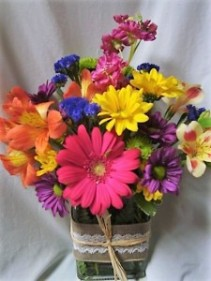 """THIS N THAT"" SUMMER FLOWERS IN A CUTE RIBBON  DETAILED CUBE VASE....FILLED WITH SEASONAL BRIGHT FLOWERS."