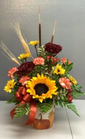 Sunflower in pumpkin tin