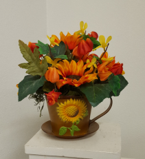 Sunflower in tin cup and saucer Silk flower arrangement