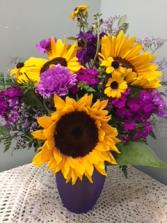 Sunflower/purple passion vase arrangement featuring sunflowers and seasonal purple flowers