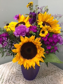Sunflower/purple passion vase arrangement featuring sunflowers and seasonal purple flowers