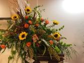 Sunflowers with a Twist casket spray