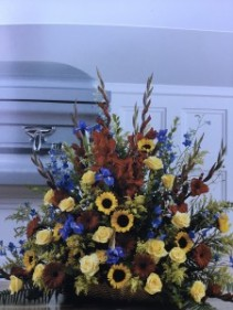 Sunflowers, yellow roses, red glads and iris Basket arrangement