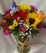Have A Sunny Day Bouquet! Seasonal flowers  arranged in a clear vase!
