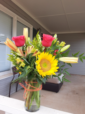 sunny and hot pink medium size vase of sunflowers and hot pink roses
