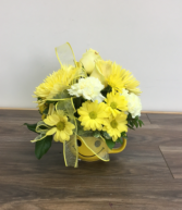 Sunny smiles Flowers arranged in a keepsake mug