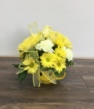 Sunny smiles Flowers arranged in a keepsake mug
