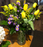 sunny tulips in a clear vase