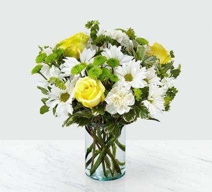 Sunshine and daisies  Fresh arrangement in a vase