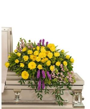Sunshine from Heaven Casket Spray Sympathy in Nevada, IA | Flower Bed