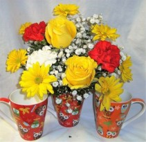 """OWL MUG"" FILLED WITH RED AND YELLOW FLOWERS INCLUDING ROSES AND ...1 WHITE CARNATION WITH BABY'S BREATH!!"