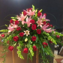 Sweet Sorrow Roses and lilies casket spray