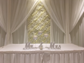 Sweetheart table backdrop Flower wall with elegant drapery