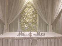 Sweetheart table backdrop Flower wall with elegant drapery