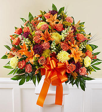 sympathy mixed in  fall colors floral arrangement