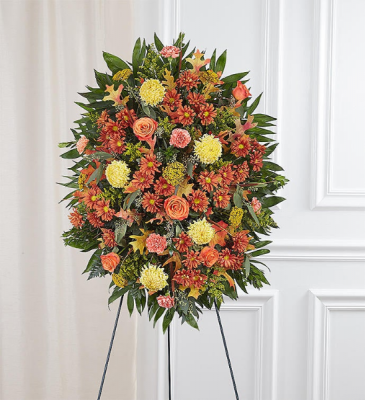 sympathy standing spray in fall colors floral arrangement