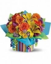 T23-1B Teleflora's Rainbow Present Flower Arrangement